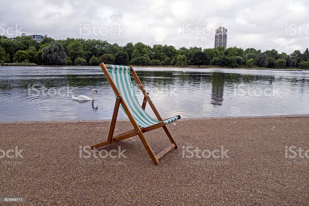 Deck Chair and Swan - Serpentine, Hyde Park, London stock photo