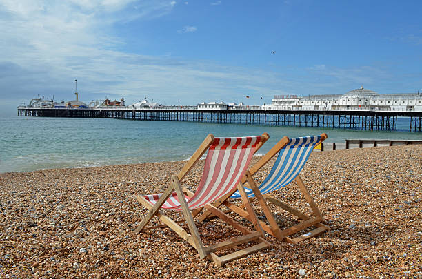 deck chair on a beach - east sussex stockfoto's en -beelden