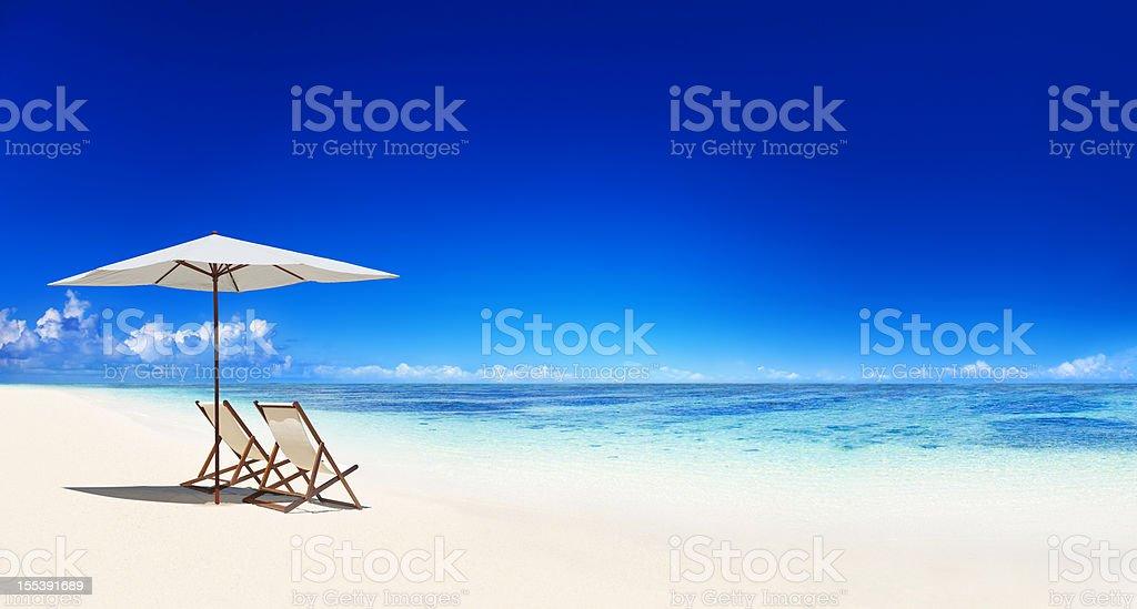 Deck chair on the beach stock photo