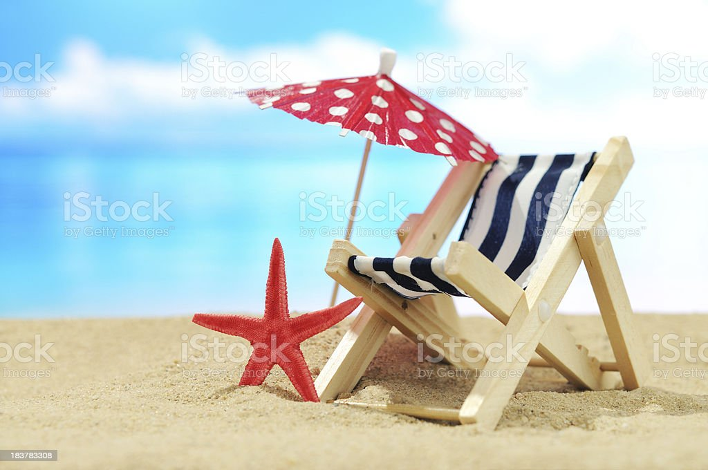 Deck chair on the beach royalty-free stock photo