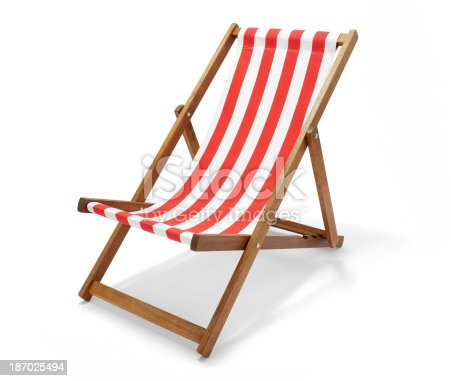 Studio photo of a red striped deck chair isolated on white with clipping path.