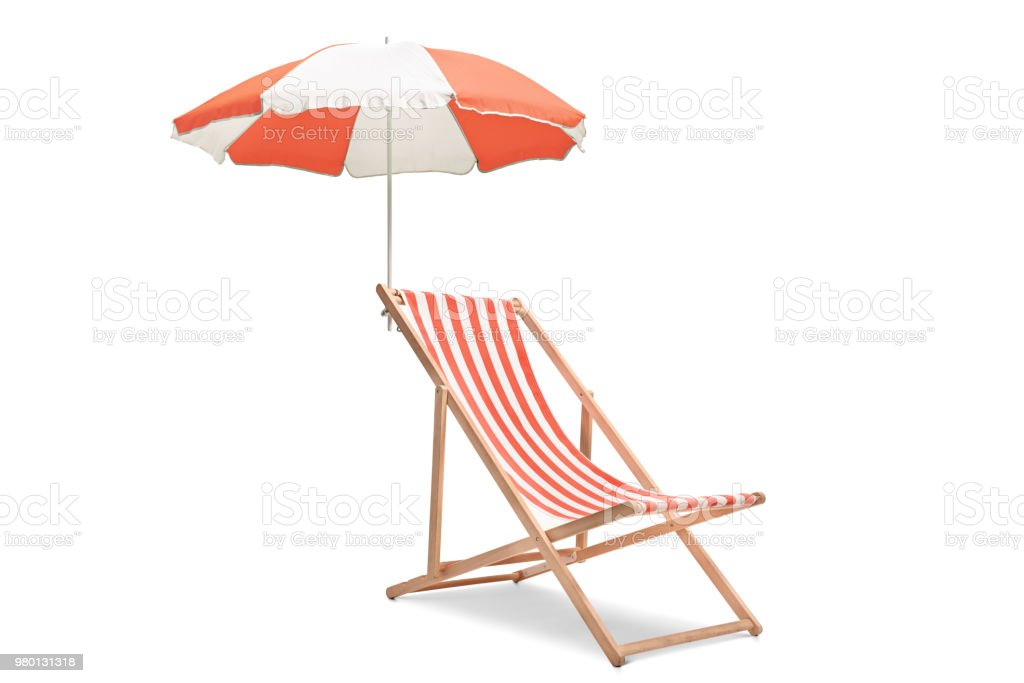 Deck chair with an umbrella stock photo