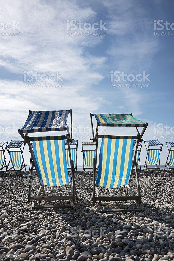 Deck Chairs at Beer, Devon, UK. stock photo