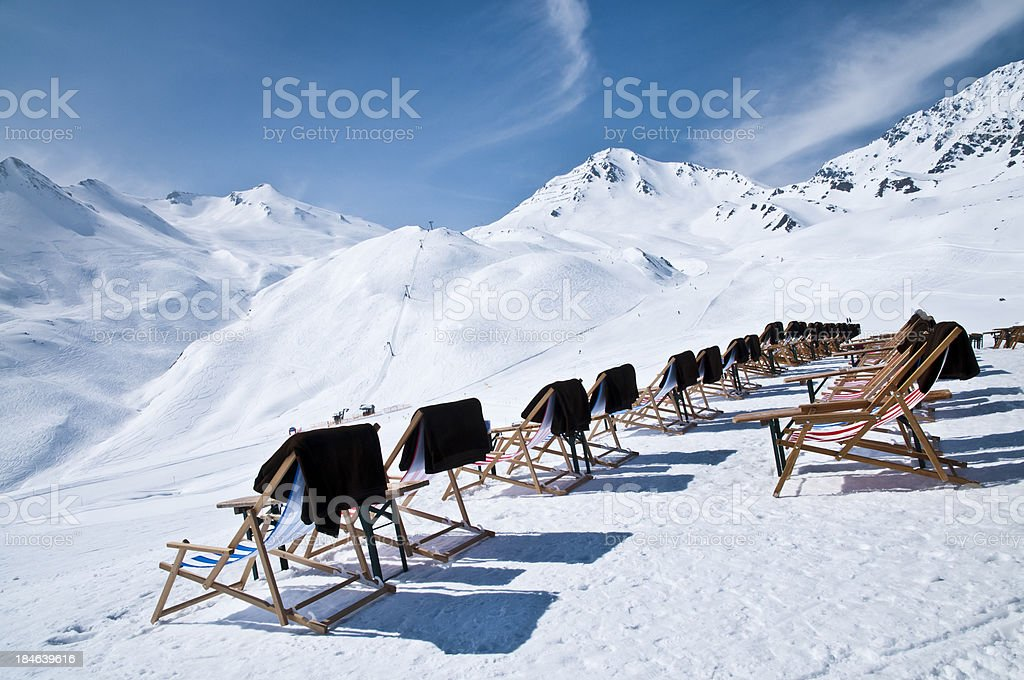 deck chairs in winter landscape royalty-free stock photo