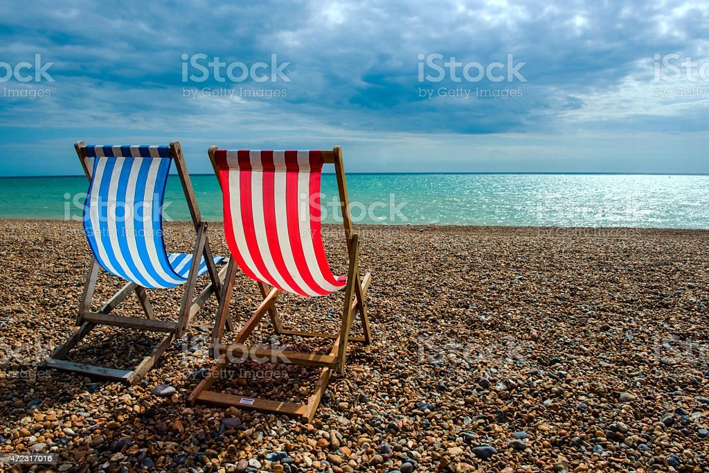 Deck chairs on beach stock photo