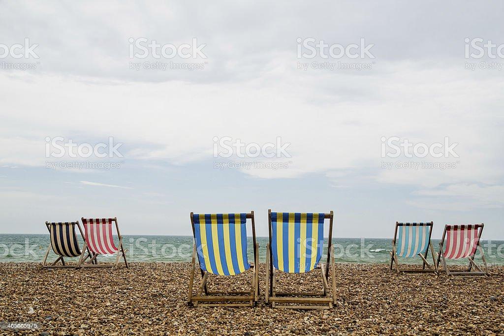 Deck Chairs on Brighton Beach, England stock photo
