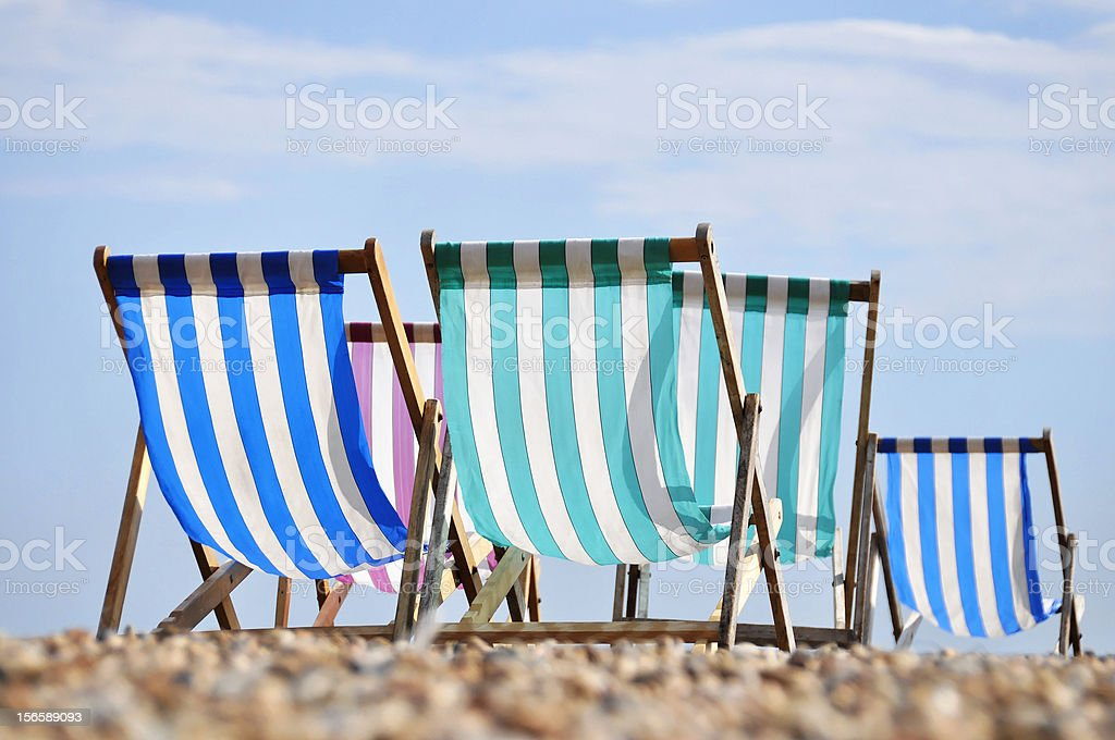 Deck chairs on Brighton beach royalty-free stock photo