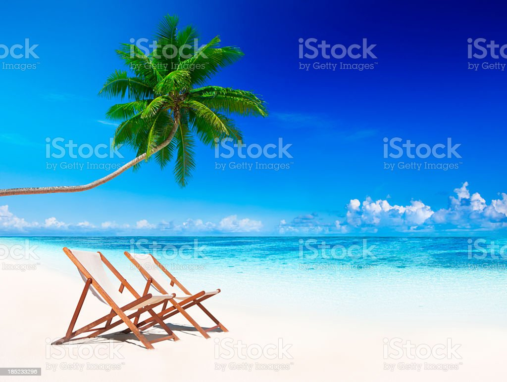 Deck chairs on the beach with breeze royalty-free stock photo