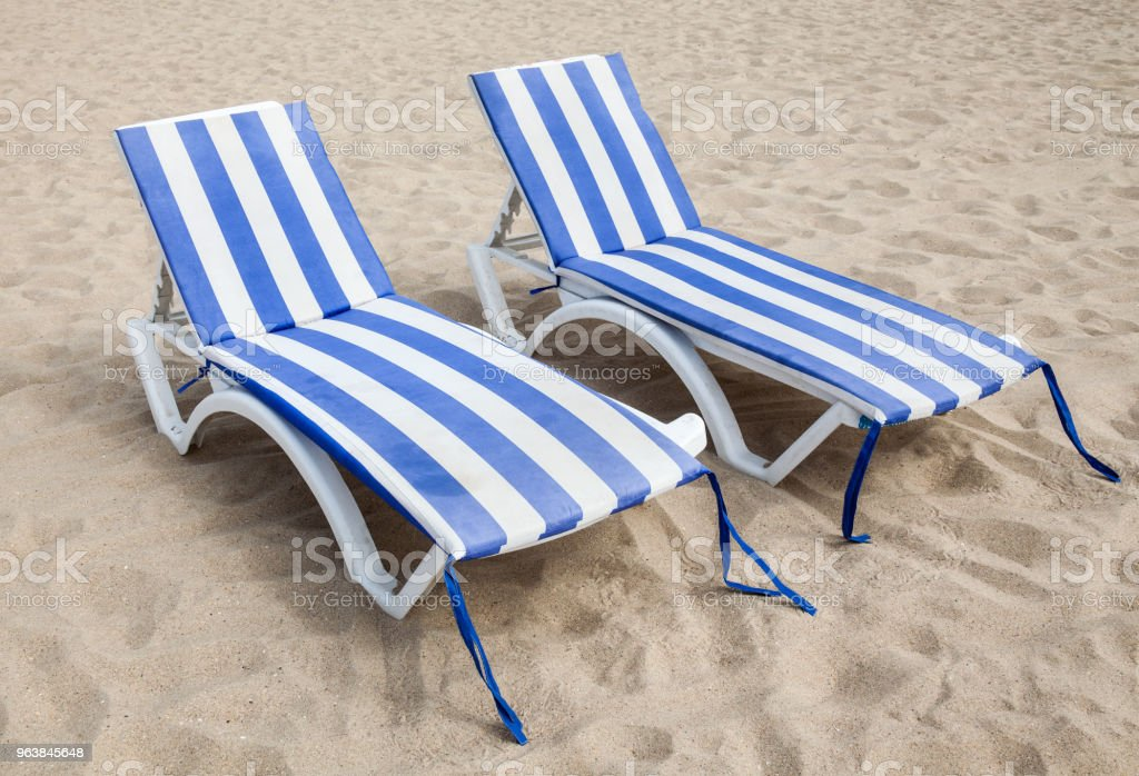 Deck chairs on the sand - Royalty-free Beach Stock Photo