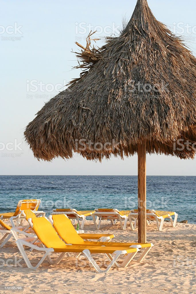 Deck chairs on tropical beach royalty-free stock photo
