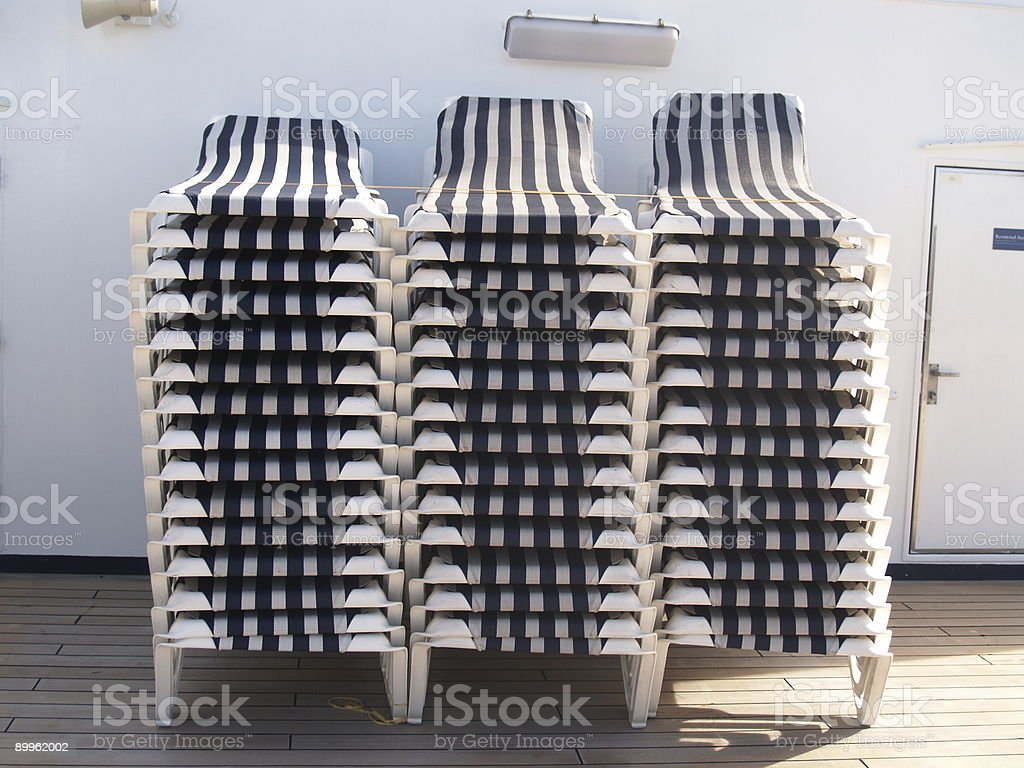 deck chairs stacked stock photo