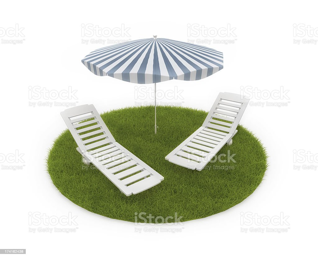 Deck chairs with umbrella on grass royalty-free stock photo