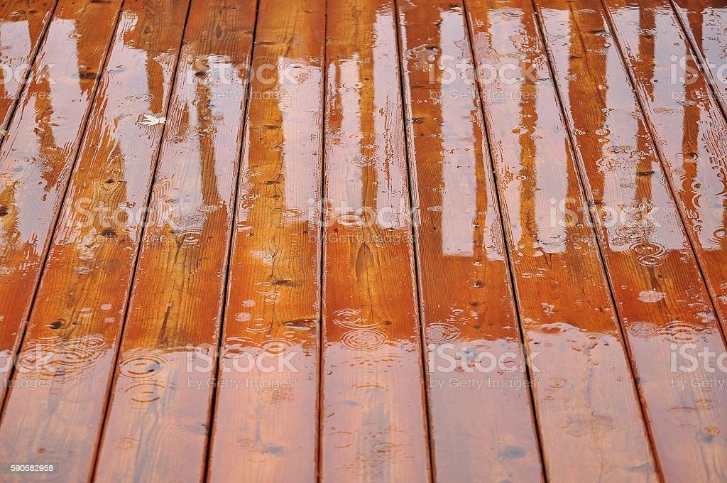 Deck floor in the rain. stock photo