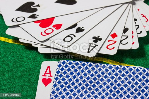 deck of cards close up on a playing field poker and casino concept