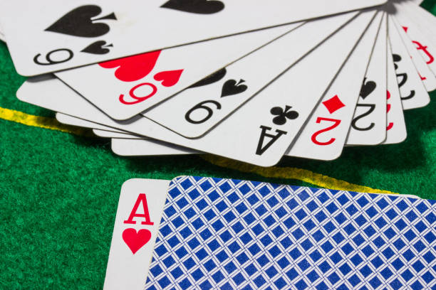 deck of cards close up on a playing field stock photo