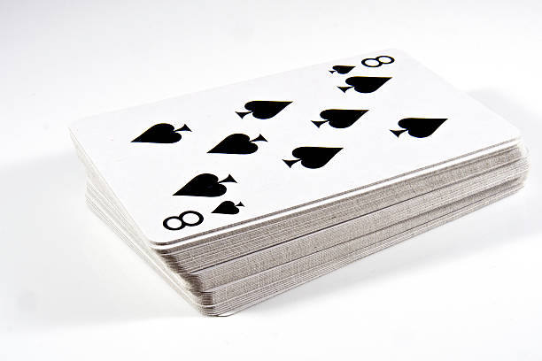 Deck of cards isolated on white - shuffled stock photo