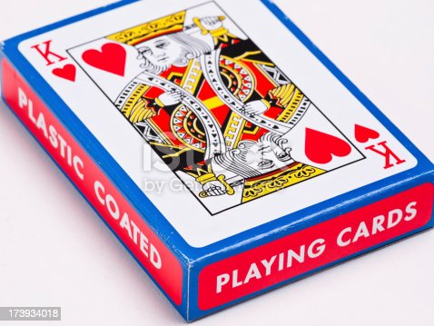 Playing cards on white surface