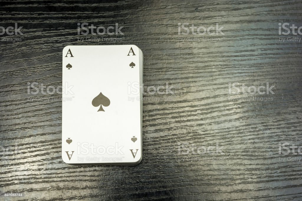 A deck of cards with ace of spades on top. – zdjęcie