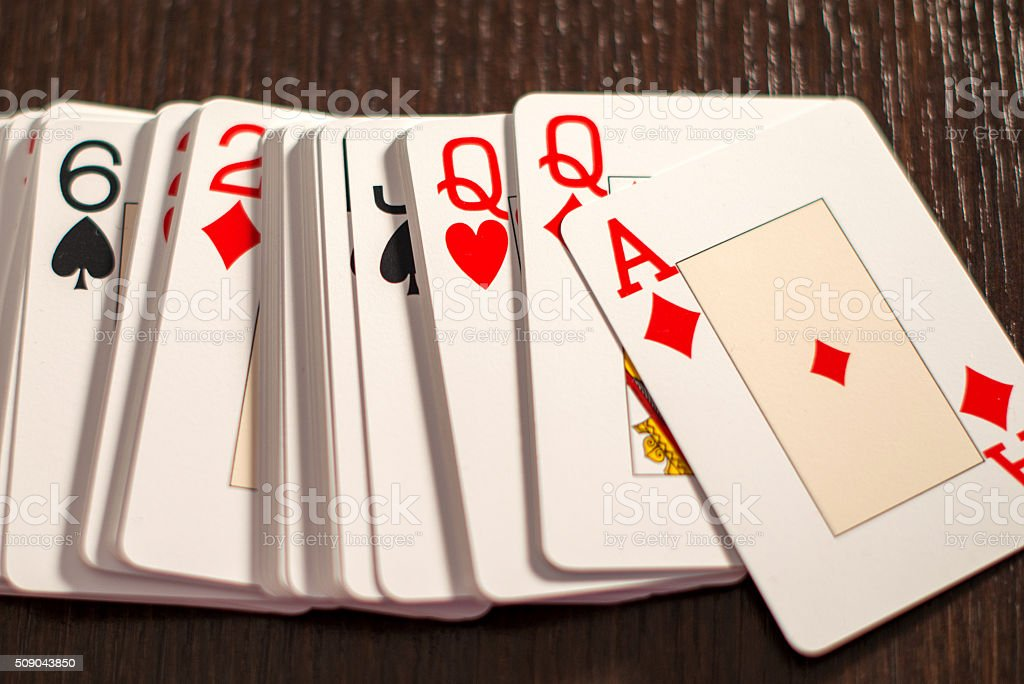 Deck of playing card spread out on a table stock photo
