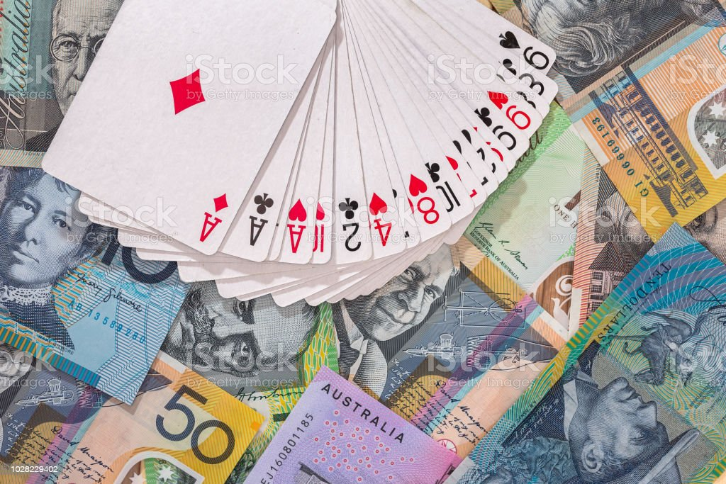 Deck of playing cards on australian dollar banknotes stock photo