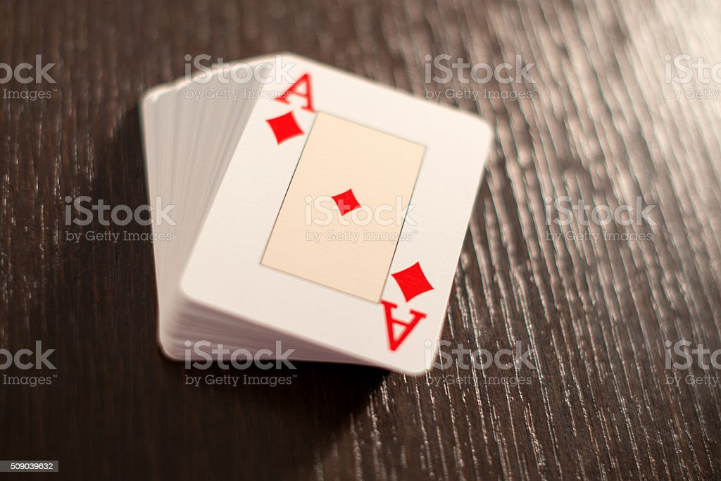 Deck of playing cards showing the ace of diamonds stock photo