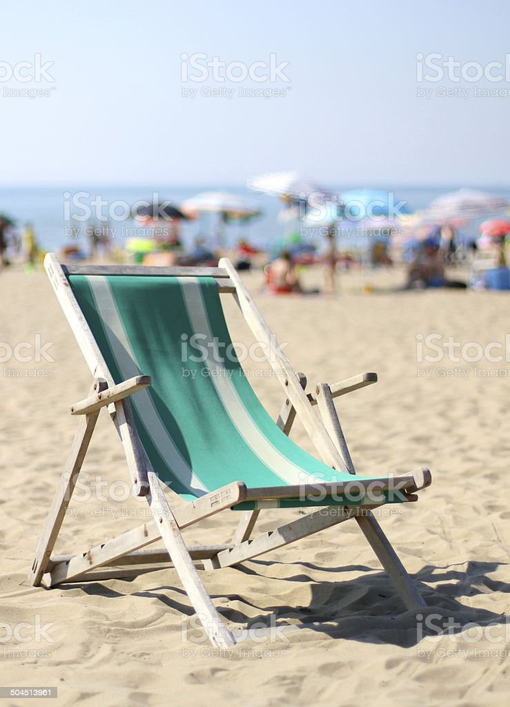 deck on beach with many umbrellas in summer stock photo