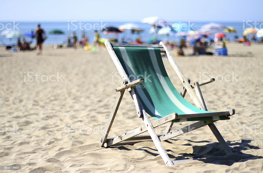 deck on sunny beach with many umbrellas in summer stock photo