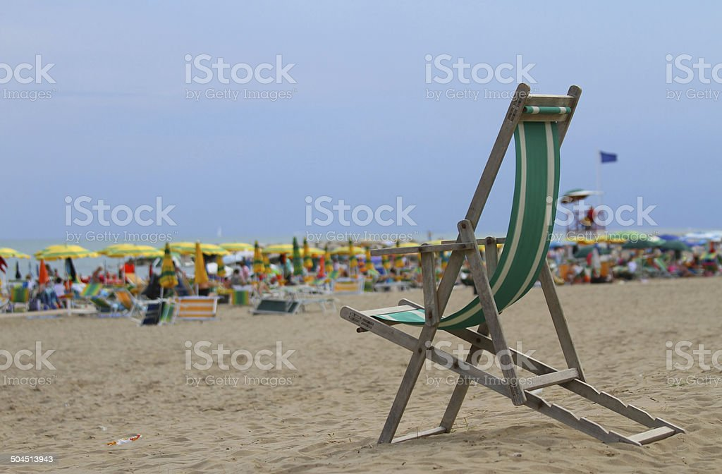 deck on the beach with many umbrellas stock photo
