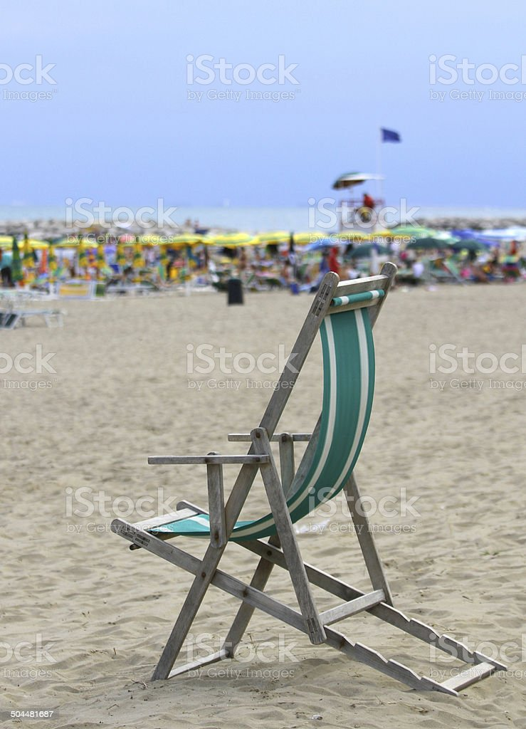 deck on the sandy beach with many umbrellas in summer stock photo