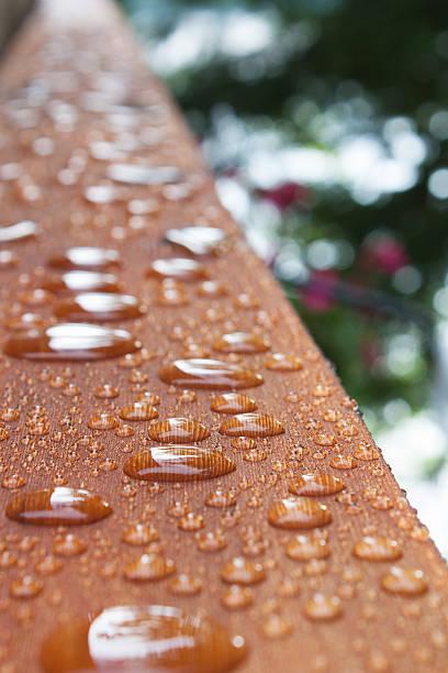 Deck rail after rain stock photo