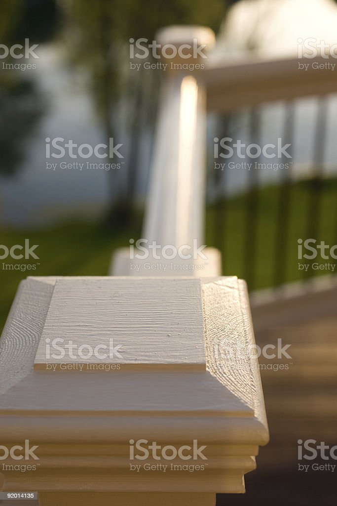 Deck Railing with pond stock photo