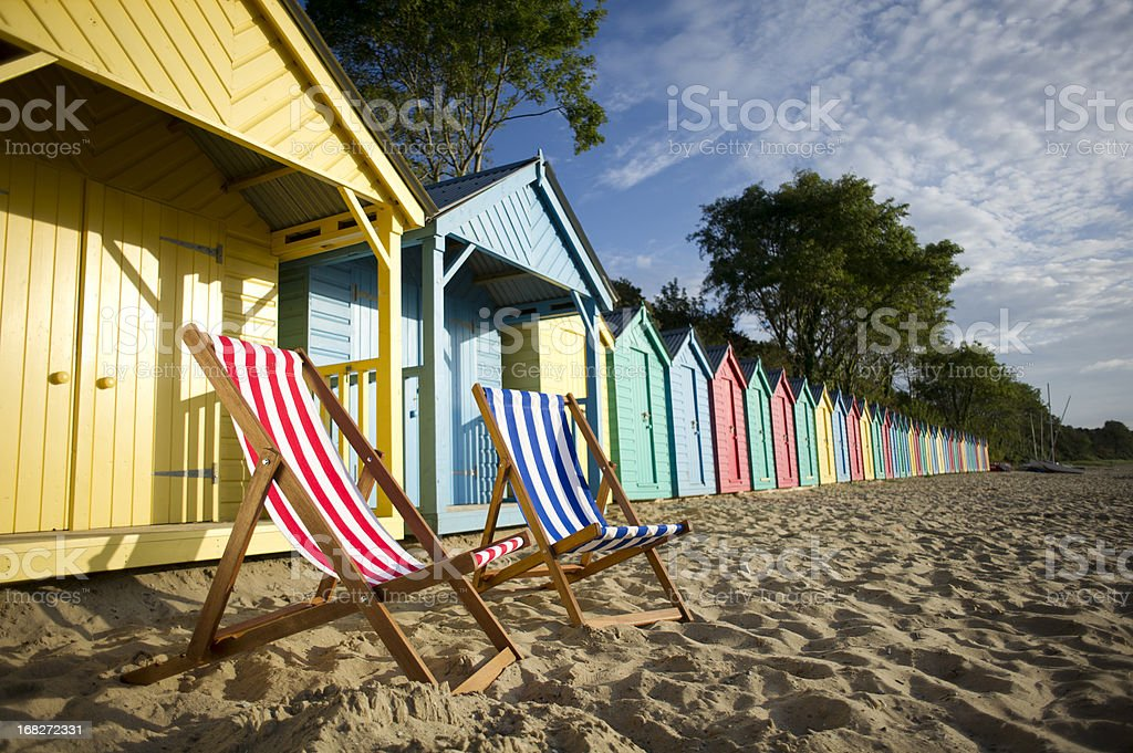 deckchair beach scene stock photo