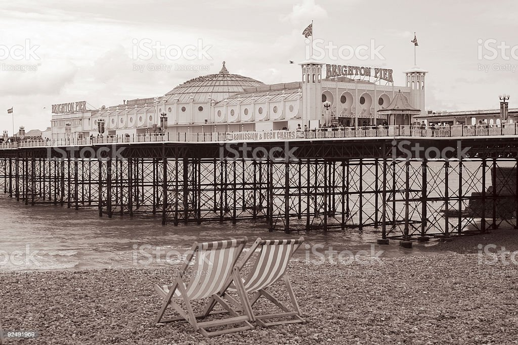 Deckchairs and Pier royalty-free stock photo