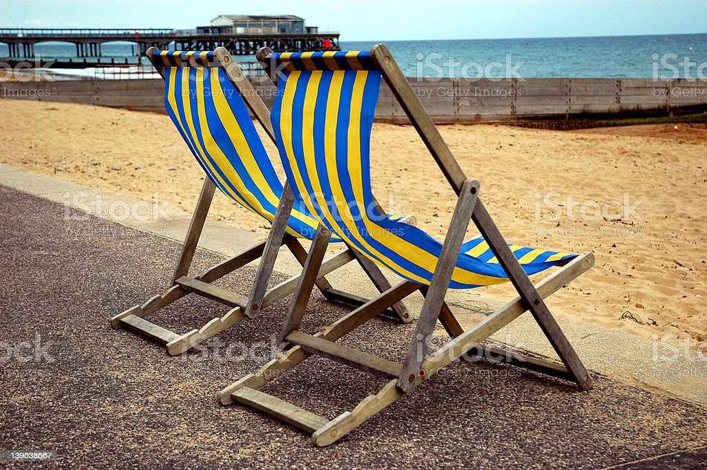 Deckchairs by the beach royalty-free stock photo