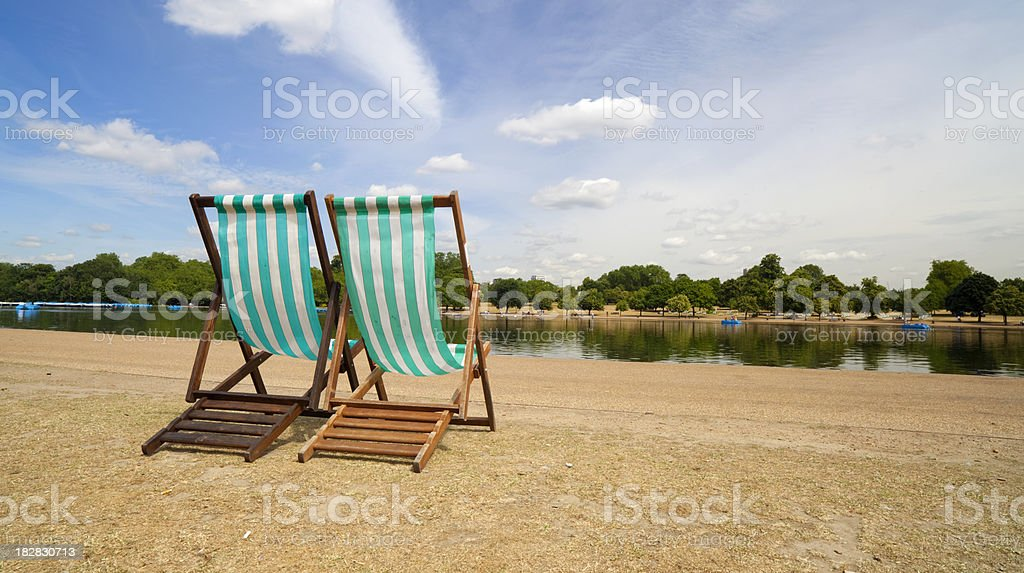 Deckchairs In Kensington Gardens stock photo