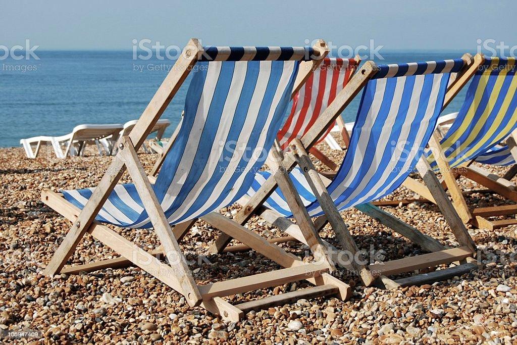 Deckchairs on beach stock photo