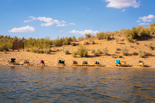 Deckchairs On Edge Of Aydar Lake In Kyzykum Desert Uzbekistan Stock Photo - Download Image Now - iStock