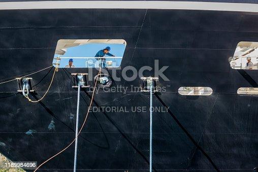 Kotor, Montenegro - September 18, 2013: Three deckhands at work during the docking of the cruise ship Azamara Quest in Kotor, Montenegro.