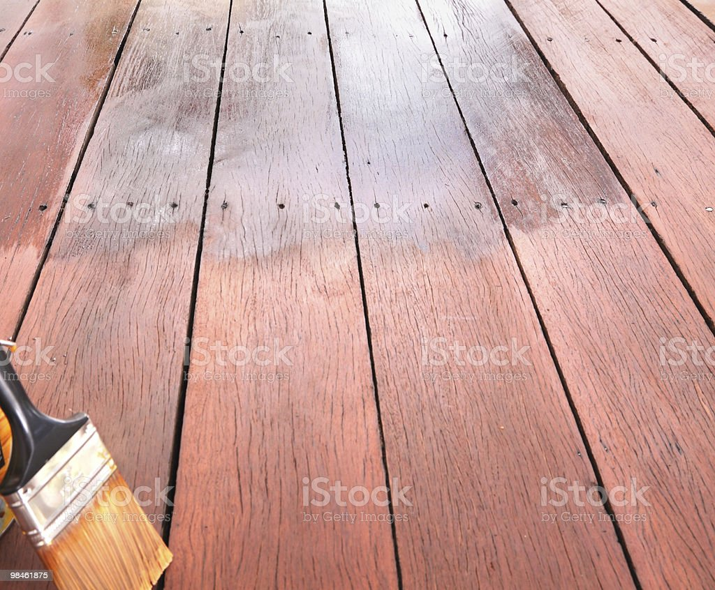 decking oil and brush on wood royalty-free stock photo
