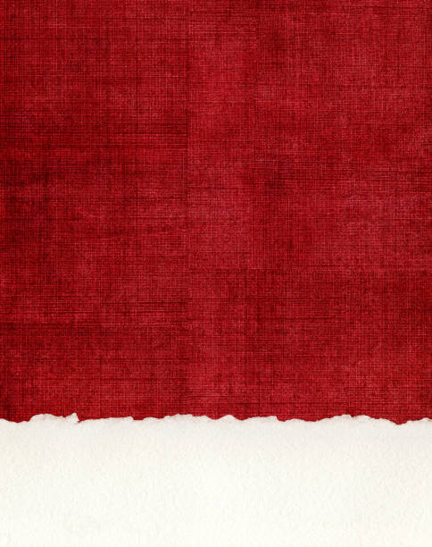 Deckled Paper Edge on Red Cloth A section of deckled edge paper on a textured, red cloth background. red cloth stock pictures, royalty-free photos & images