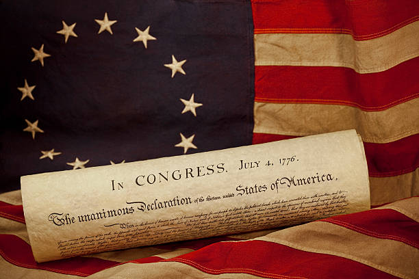 USA Declaration of Independence Lying on Grungy Betsy Ross Flag stock photo