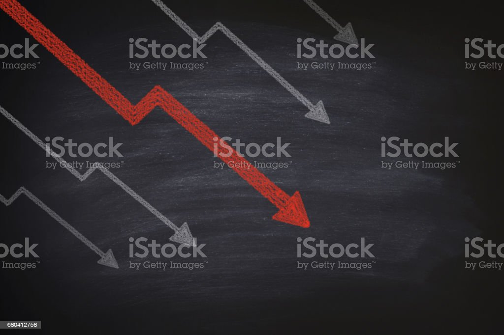 Decline in stocks on blackboard stock photo