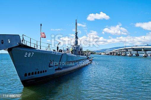 Honolulu, Hawaii, USA - February 20, 2018: Decommissioning submarine (USS Bowfin Submarine - World War II) parked at Pearl harbor at sunny day, Honolulu, Hawaii, USA.