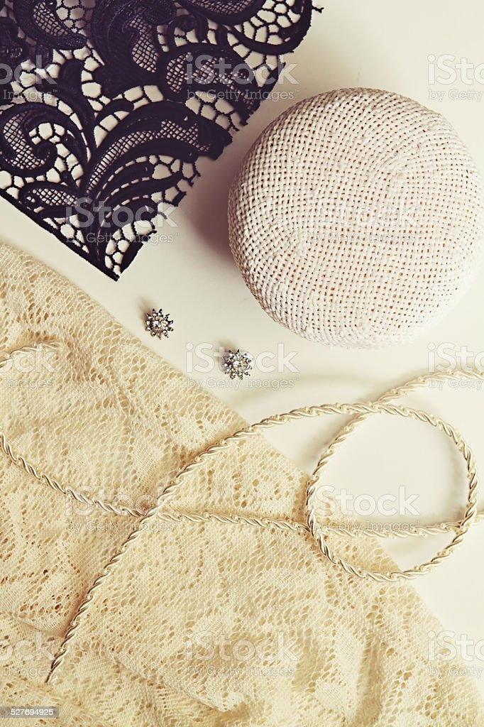 Deconstructed millinery materials lace and hat block stock photo