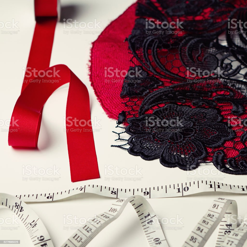 Deconstructed red and black millinery materials stock photo