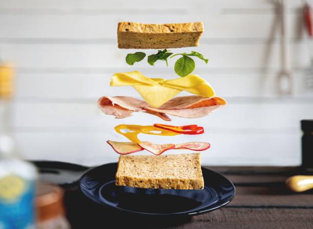 deconstructed sandwich layers in kitchen - panino ripieno foto e immagini stock