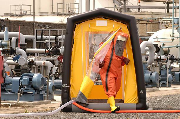 decontaminates - white suit stock photos and pictures