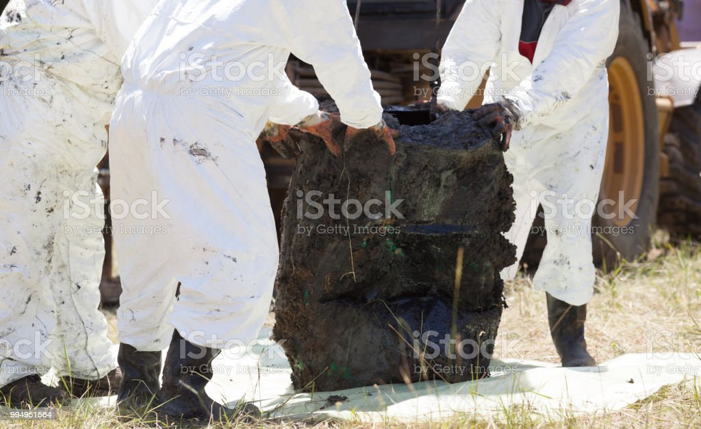 Decontamination team cleaning toxic waste in the nature stock photo