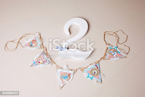 istock Decor in the style of sea travel. Sea thematic  decoration. Beautiful decoration for second birthday party 843996422