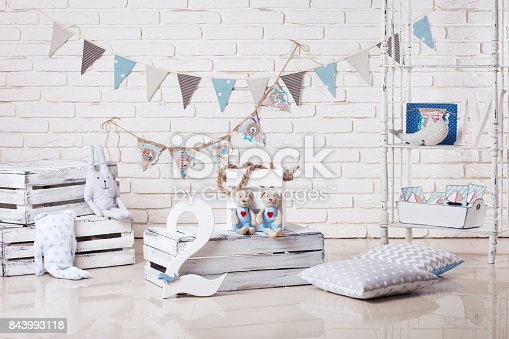 istock Decor in the style of sea travel. Sea thematic photo session decoration of a daylight studio. 843993118